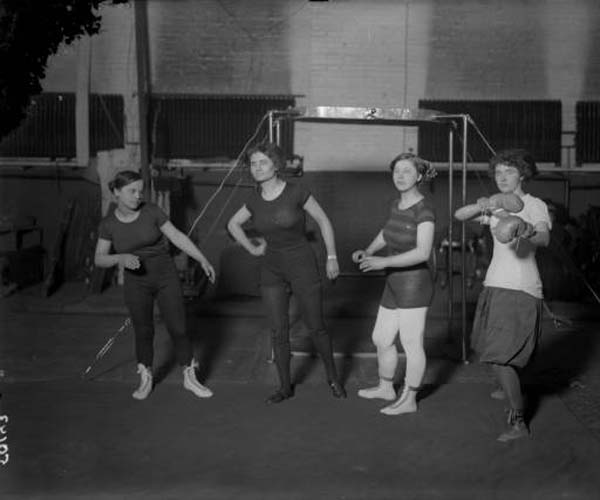 Flash From the Past – Female with Boxing Gloves in Gym
